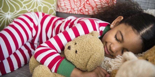 Mixed race girl sleeping on sofa