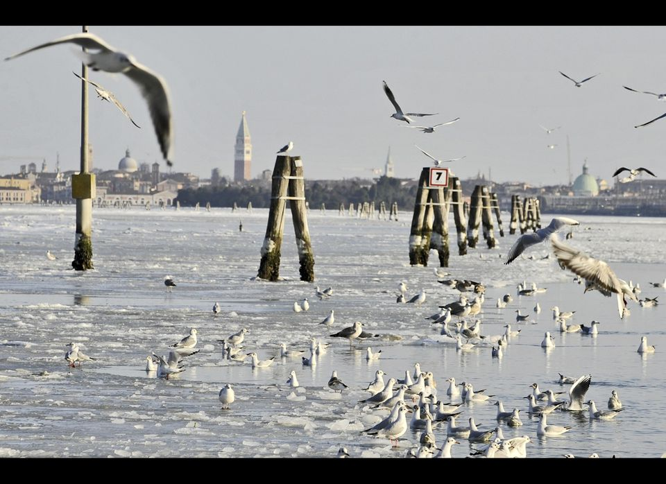 The San Giuliano channel linking Venice to Mestre is partially frozen because of unusually low temperatures. (AP Photo/Luigi