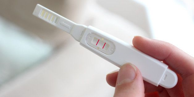 Woman holding a pregnancy test device