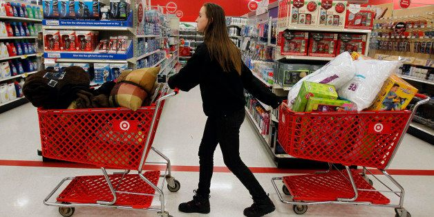 "A woman pulls shopping carts through the aisle of a Target store on the shopping day dubbed ""Black Friday"" in Torrington, Con"