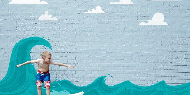 Boy surfing on cartoon wave