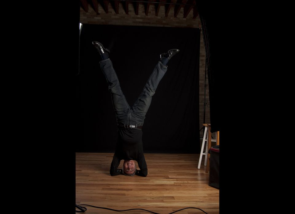 From Laura: <em>The yogi is cellist and orchestra conductor David Lockington, seen here doing a headstand in Grand Rapids, wh
