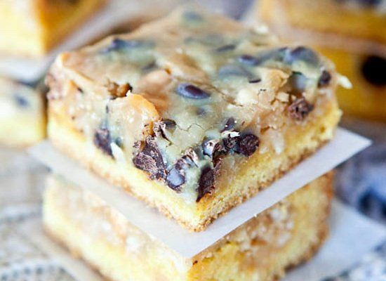 "<strong>Get the <a href=""http://www.loveveggiesandyoga.com/2012/03/coconut-peanut-butter-magic-cake-bars.html"" target=""_hplin"