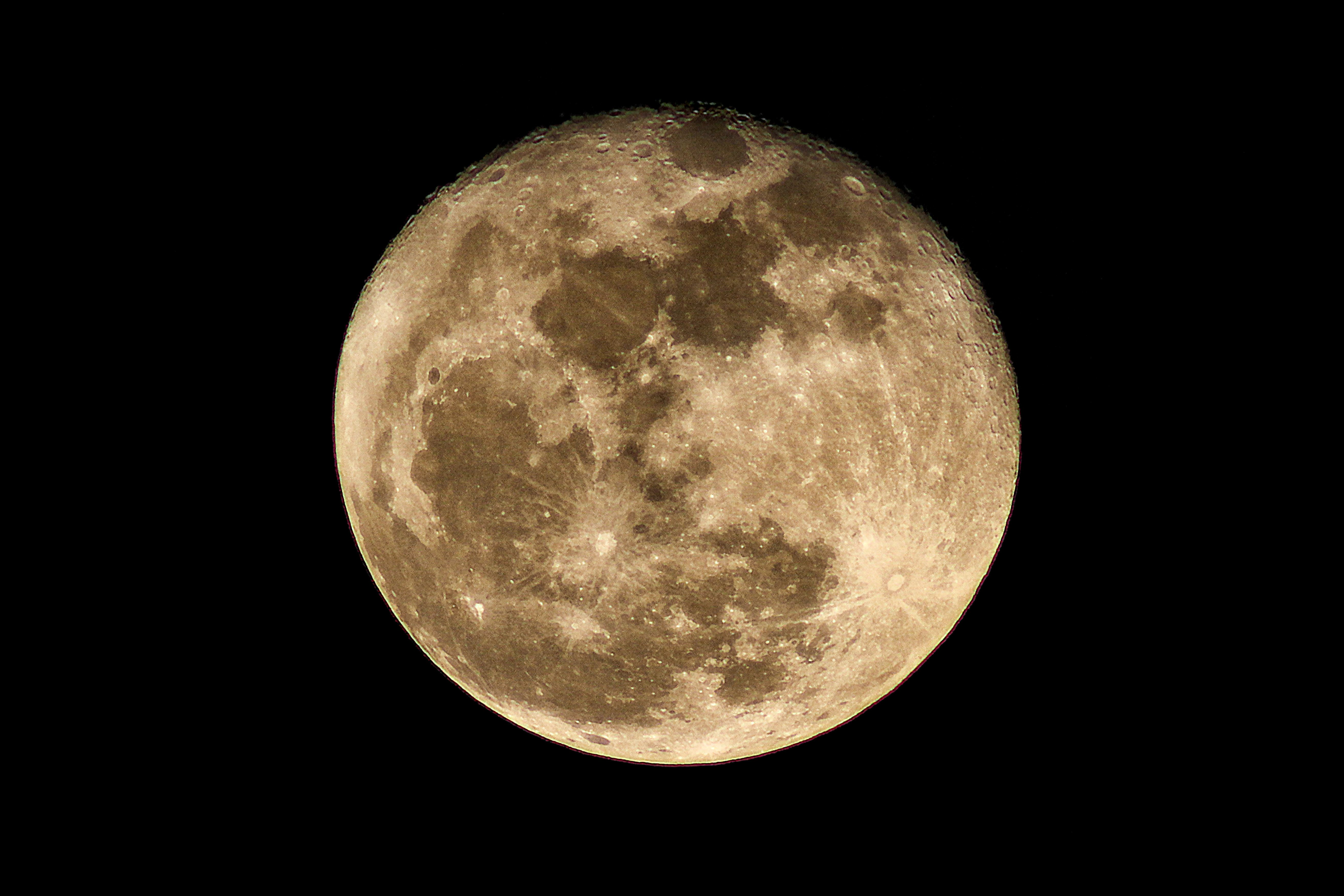 A supermoon is the coincidence of a full moon or a new moon with the closest approach the Moon makes to the Earth on its elliptical orbit, resulting in the largest apparent size of the lunar disk as seen from Earth. The technical name is the perigee-syzygy of the Earth–Moon–Sun system. The term supermoon is not astronomical, but originated in modern astrology. The association of the Moon with both oceanic and crustal tides has led to claims that the supermoon phenomenon may be associated with increased risk of events such as earthquakes and volcanic eruptions, but this effect is very slight. The opposite phenomenon, an apogee-syzygy, has been called a micromoon, though this term is not as widespread as supermoon.