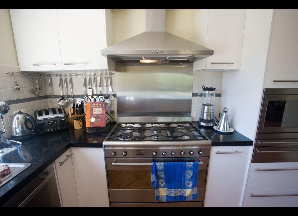 Protect your wall from kitchen grease and stains by installing a stainless steel backsplash behind the stove. It'll be easier