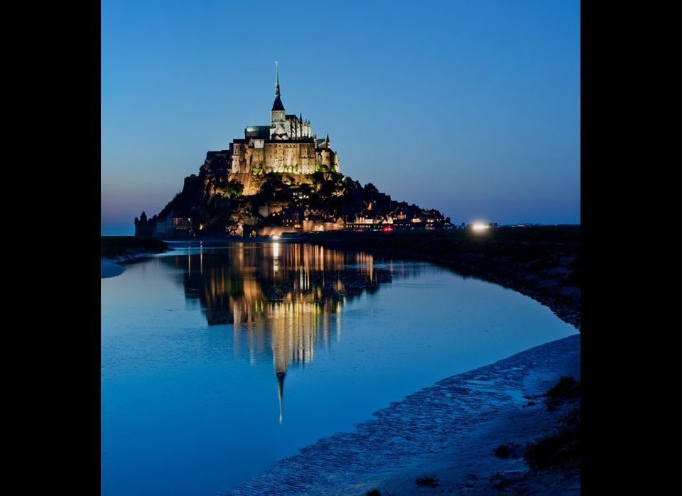 Located about a half mile off France's northwestern coast at the mouth of the Couesonon River, Le Mont Saint Michel was first