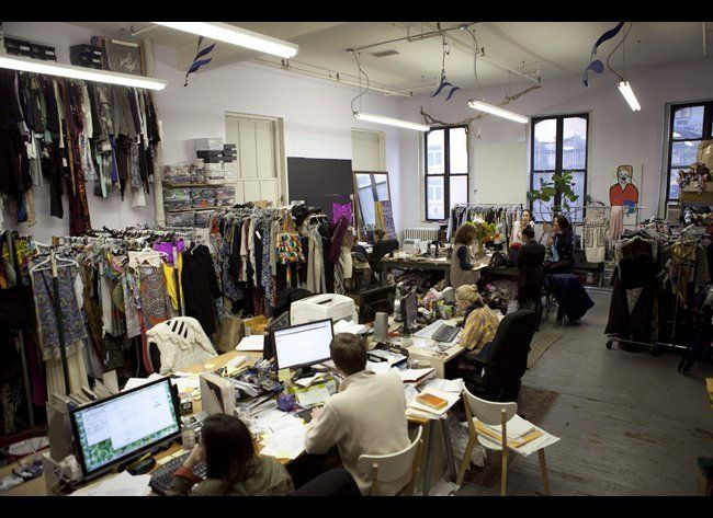 The studio is full clothing samples, accessories <i>and</i> busy working bodies.