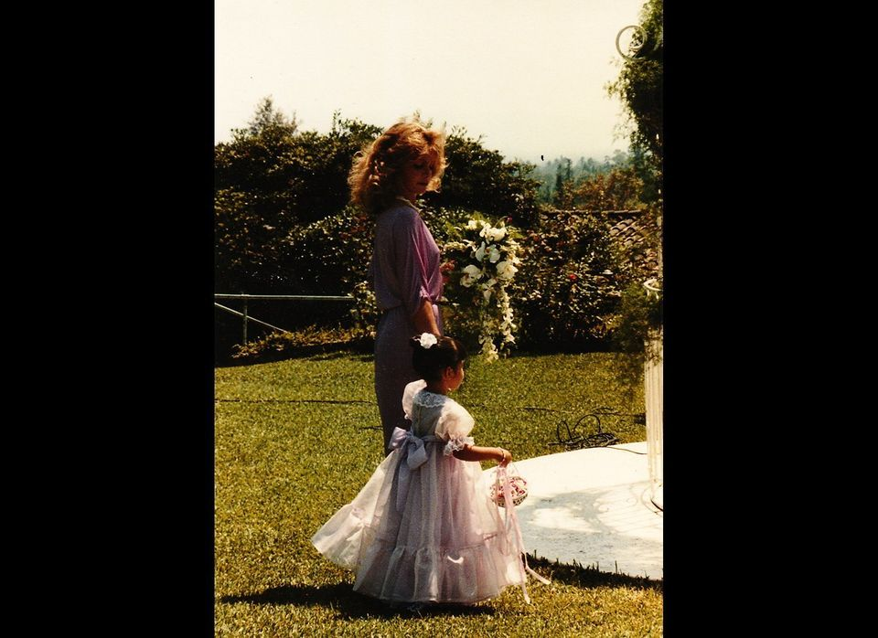 """""""I must have been 2 years old. Here with my cousin Cici. Such a girly girl, princess dress."""""""