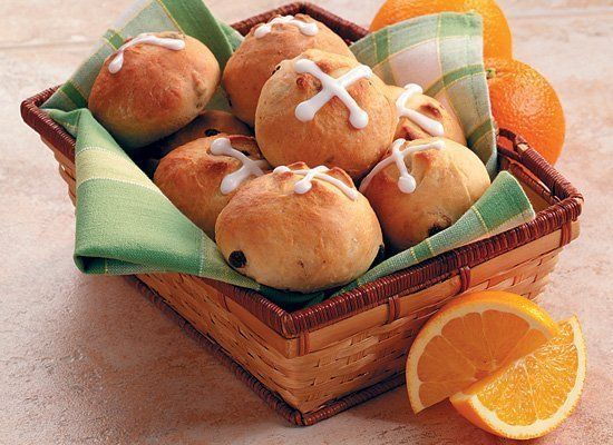 Put a zesty twist on the classic Easter hot cross buns with orange. This recipe uses both the juice and grated peel. Decorate