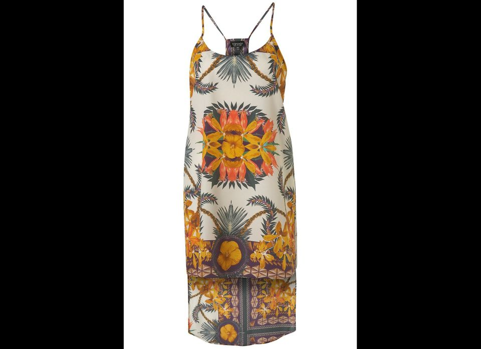 "Borrow the topical vibe from <a href=""http://www.mytheresa.com/us_en/printed-silk-midi-dress.html?quid=61029863468S1086032T&g"