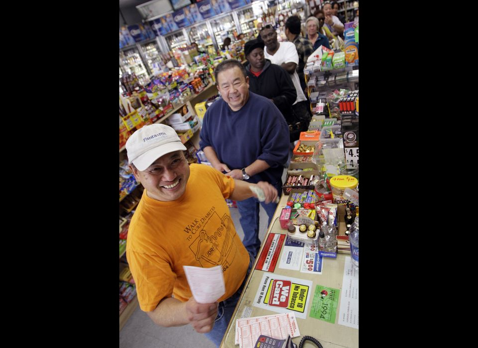 Michael Mar purchases lottery tickets after waiting in a long line at a liquor store in Mountain View, Calif., Thursday, Marc