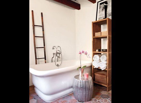 A bamboo ladder and terracotta floors make this simple bathroom in Ellen Pompeo's Hollywood Hills home feel rustic and elegan