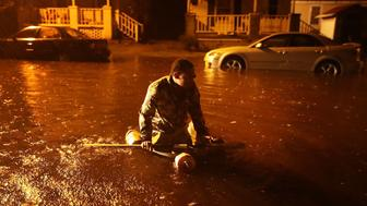 NEW BERN, NC - SEPTEMBER 13:  Michael Nelson floats in a boat made from a metal tub and fishing floats after the Neuse River went over its banks and flooded his street during Hurricane Florence September 13, 2018 in New Bern, North Carolina. Some parts of New Bern could be flooded with a possible 9-foot storm surge as the Category 2 hurricane approaches the United States.  (Photo by Chip Somodevilla/Getty Images)