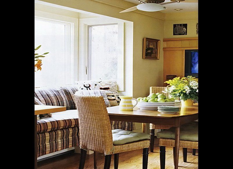 We love how much natural light pours into this sunny breakfast nook. A cozy couch pushed against the window adds extra seatin