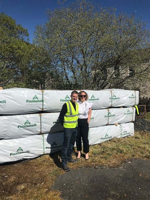 Jennie Riding and her husband Neil taking delivery of their log cabins