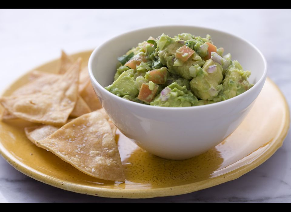 Guacamole may seem like a no brainer when it comes to topping these corn chips, but you'd be surprised by how many people for