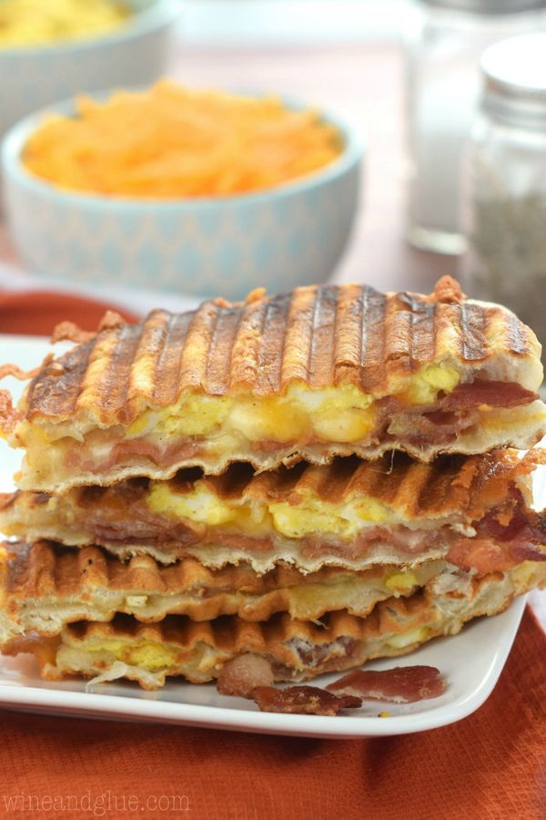 """<strong>Get the <a href=""""http://www.wineandglue.com/2015/02/bacon-eggs-biscuit-breakfast-panini.html"""" target=""""_blank"""">Bacon a"""