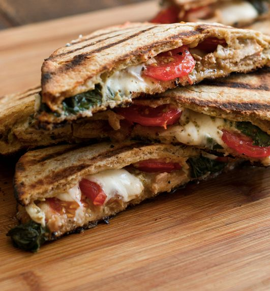 """<strong>Get the <a href=""""http://www.cookthestory.com/2014/04/21/grilled-chicken-panini-with-yogurt-pesto-spread/"""" target=""""_bl"""