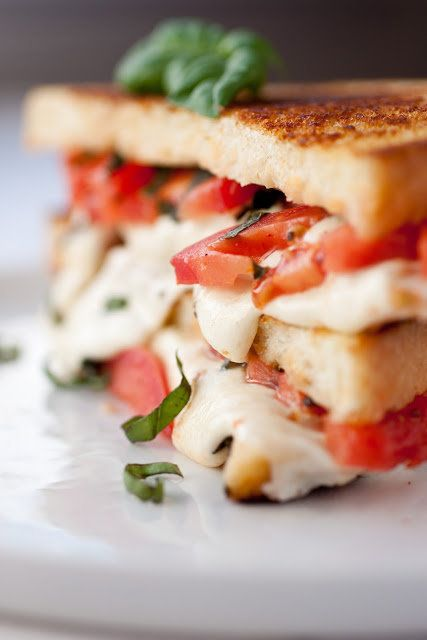 """<strong>Get the <a href=""""http://www.cookingclassy.com/2012/11/caprese-grilled-cheese/"""">Caprese Grilled Cheese recipe from Coo"""