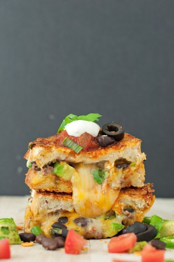 """<strong>Get the <a href=""""http://bsinthekitchen.com/the-loaded-nacho-game-day-grilled-cheese/"""">Loaded Nacho Grilled Cheese rec"""