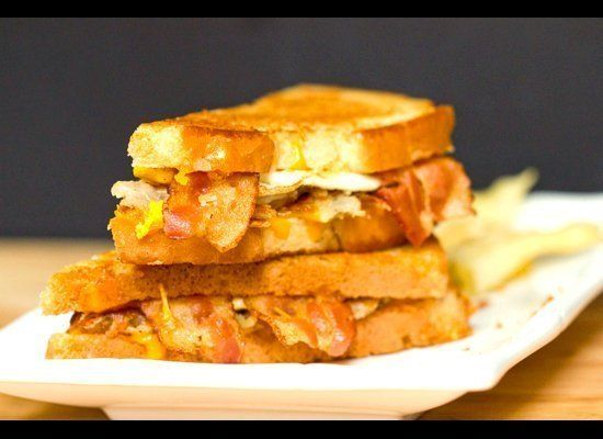 """<strong>Get the <a href=""""http://www.browneyedbaker.com/2012/08/01/bacon-egg-hash-brown-grilled-cheese-sandwich/"""" target=""""_hpl"""