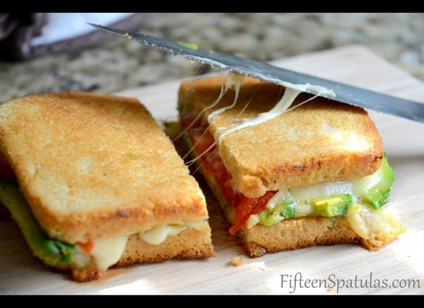 """<strong>Get the <a href=""""http://www.fifteenspatulas.com/2012/04/02/grilled-cheese-with-avocado-and-heirloom-tomato/"""" target="""""""