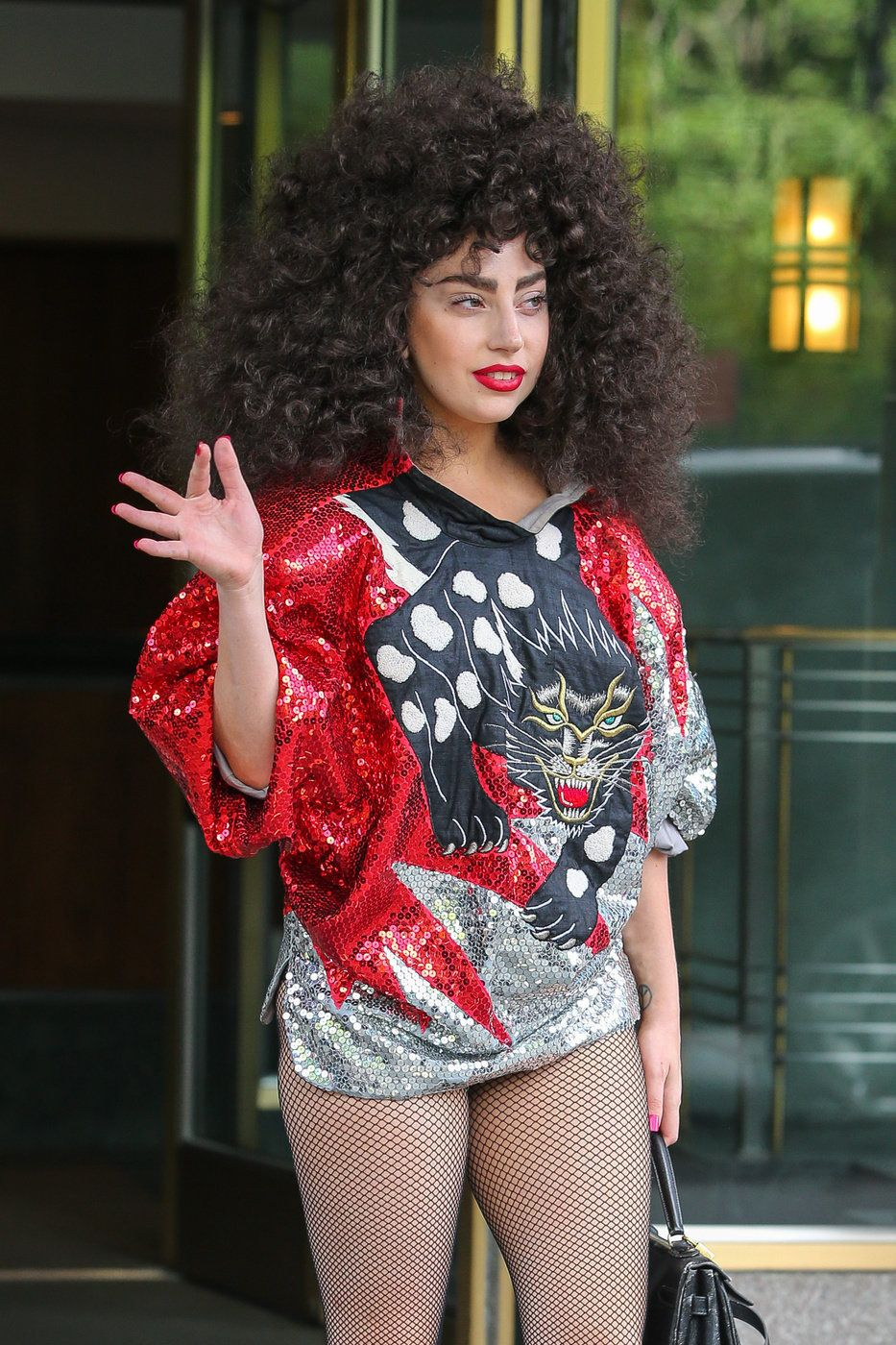 Lady Gaga rocked some 80's style while leaving her apartment building in New York City on June 6.