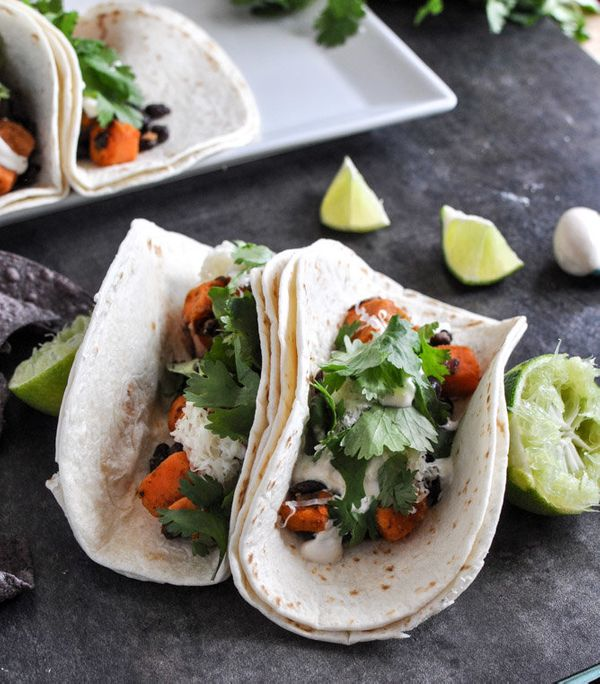 """<strong>Get the <a href=""""http://www.howsweeteats.com/2012/12/embarrassingly-easy-smoky-sweet-potato-and-black-bean-tacos/"""" ta"""