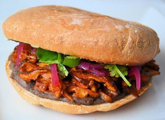 """<strong>Get the <a href=""""http://www.namelymarly.com/2011/03/americas-top-10-new-sandwiches-veganized-pibil-torta-sandwich/"""" t"""