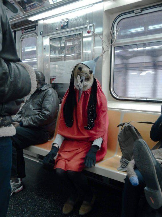 Rae Swon's demon-bird riding the subway.