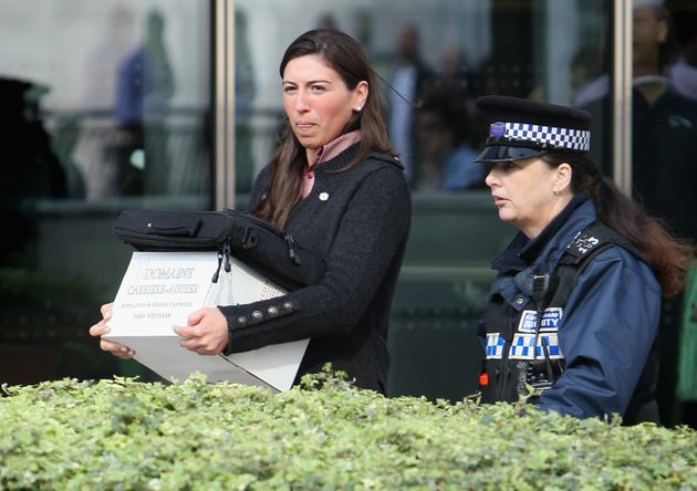 A woman leaves Lehman Brothers' Canary Wharf office carrying belongings on September 15,