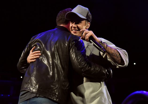 The pair share a hug on stage in
