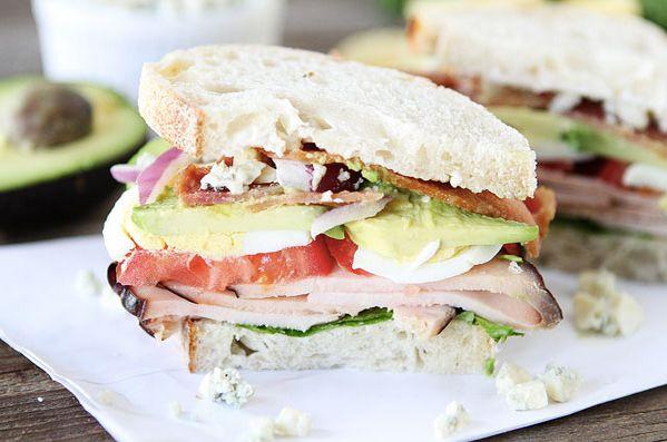"<strong>Get the <a href=""http://www.twopeasandtheirpod.com/cobb-salad-sandwich/"" target=""_blank"">Cobb Salad Sandwich recipe</"
