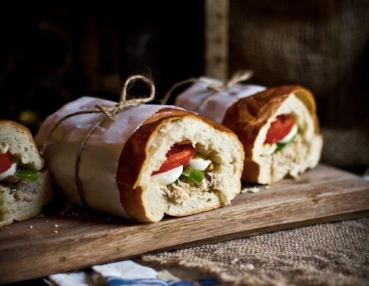"""<strong>Get the <a href=""""http://www.adventures-in-cooking.com/2012/08/pan-bagnat-tuna-nicoise-sandwich.html"""" target=""""_blank"""">"""