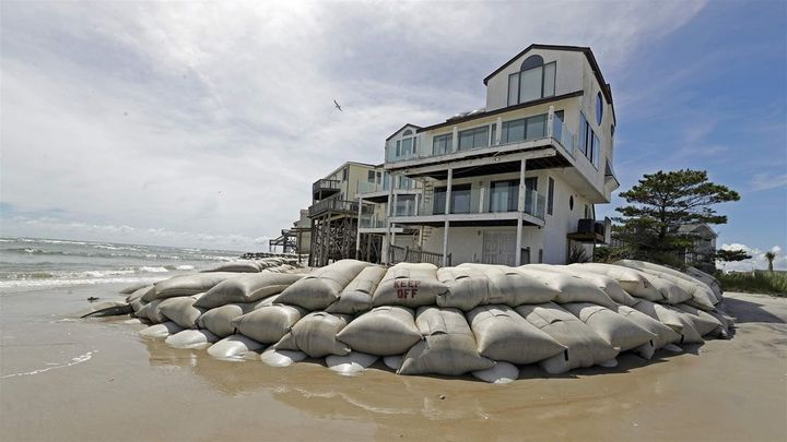 Rows of sandbags surround a home on North Topsail Beach, North Carolina, in preparation of Hurricane Florence. More than a mi