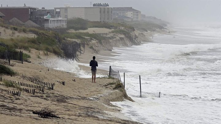 As Hurricane Florence approached the Southeastern Coast, a heavy surf crashed the dunes at high tide Thursday in Nags Head, N