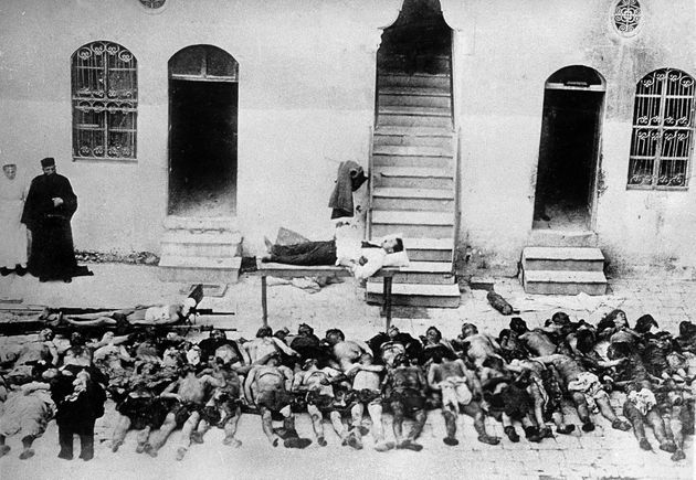 Corpses of Greek and Armenian victims from Smyrne are lined up side by side on a sidewalk in the city....