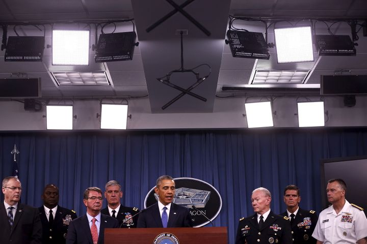 President Barack Obama briefs reporters on U.S. efforts against the self-described Islamic State. Obama expanded the 2001 aut