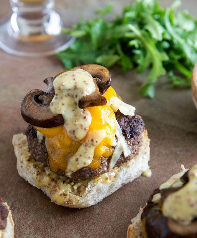 """<strong>Get the <a href=""""http://www.howsweeteats.com/2013/04/cheeseburgers-with-sauteed-mushrooms-arugula-and-dijon-aioli/"""" t"""