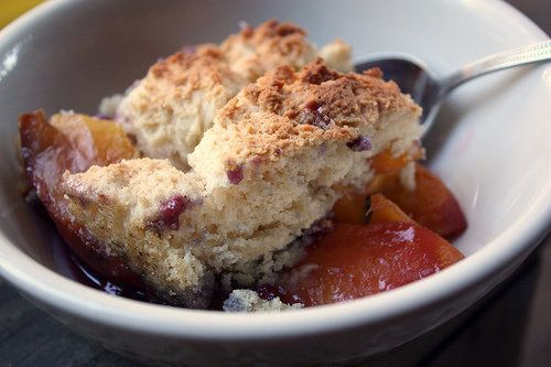 "<strong>Get the <a href=""http://www.completelydelicious.com/2010/08/dutch-oven-huckleberry-peach-cobbler.html"" target=""_blank"