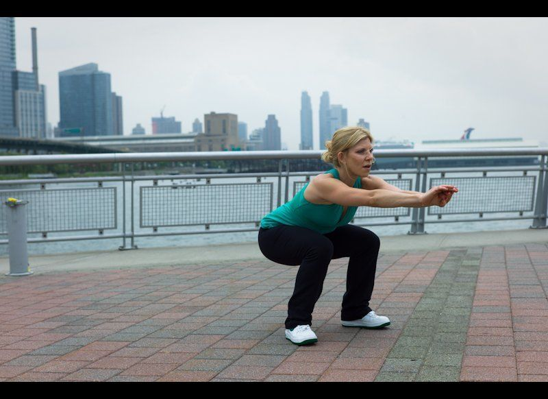 <em>Muscles:</em> Quads, Butt, Hamstring, Inner/Outer Thighs <br><br> -Start in a standing position with the feet wider tha