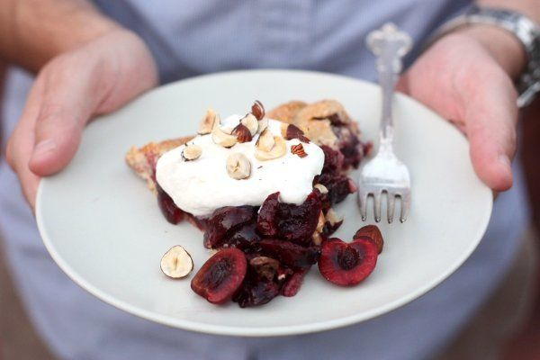 "<strong>Get the <a href=""http://www.completelydelicious.com/2013/07/sweet-cherry-and-hazelnut-galette.html"" target=""_blank"">S"