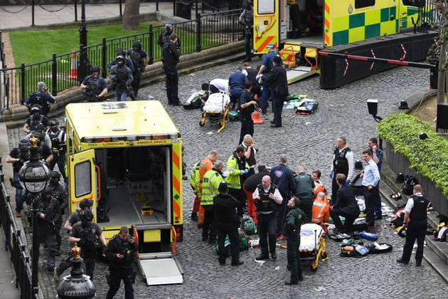 Emergency services at the scene outside the Palace of Westminster, London, where Pc Keith Palmer was...