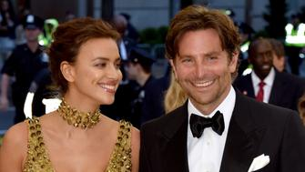 NEW YORK, NY - MAY 07:   Irina Shayk and Bradley Cooper attend the Heavenly Bodies: Fashion & The Catholic Imagination Costume Institute Gala at The Metropolitan Museum of Art on May 7, 2018 in New York City.  (Photo by John Shearer/Getty Images for The Hollywood Reporter)