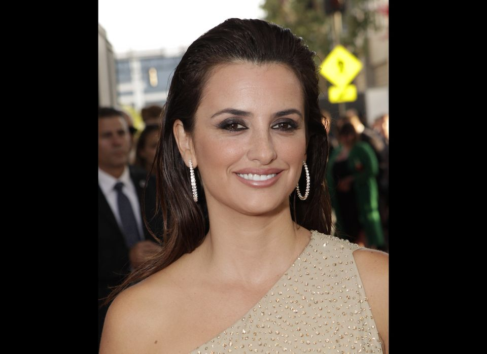 "We love Penelope Cruz's slicked back, classy look at the L.A. premier of ""To Rome With Love."" Her look on the red carpet is c"