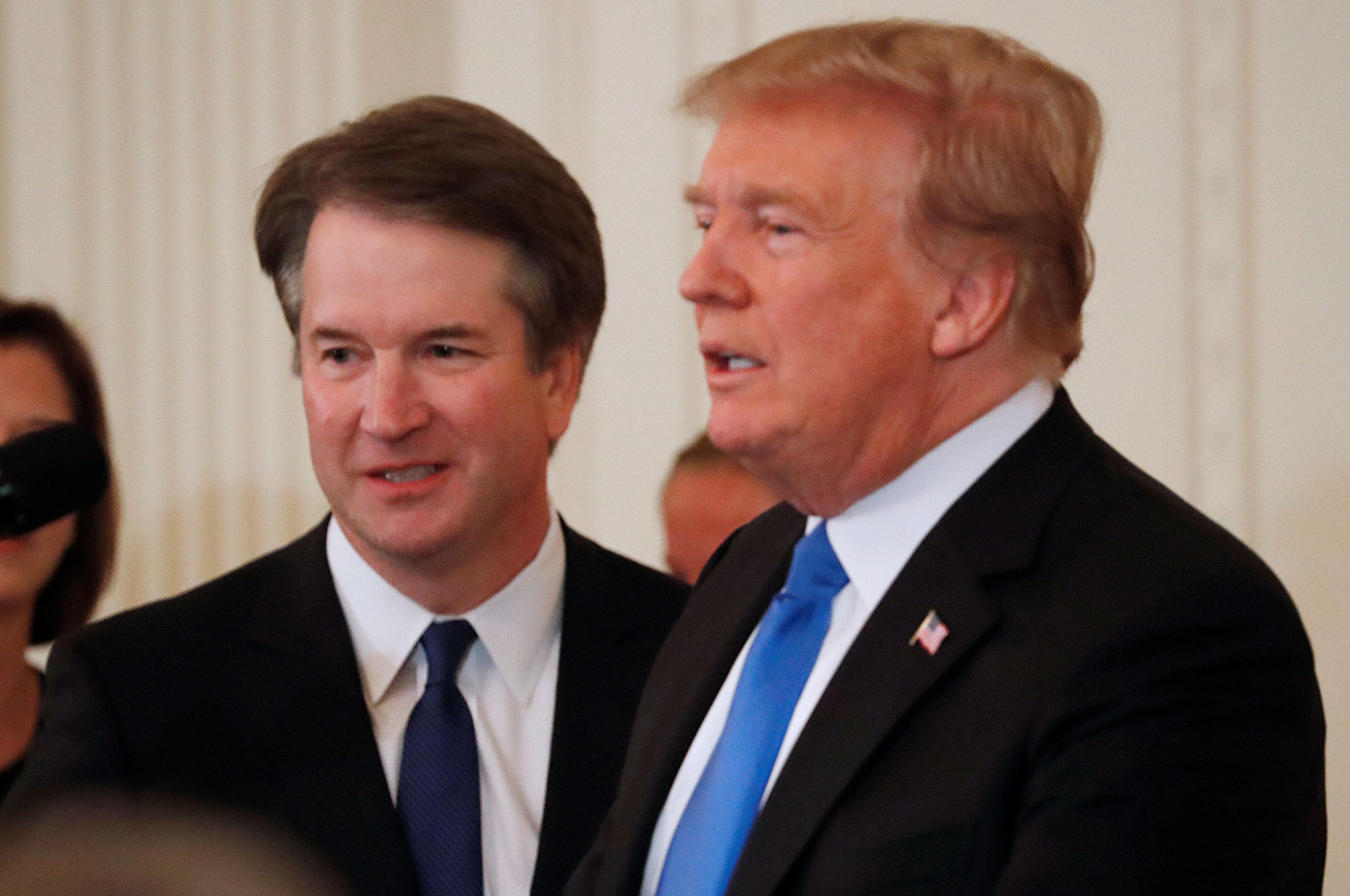U.S. President Donald Trump and his nominee for the U.S. Supreme Court Judge Brett Kavanaugh are seen in the East Room of the White House in Washington, U.S., July 9, 2018.  REUTERS/Jim Bourg
