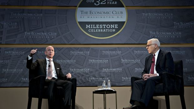 Jeff Bezos, founder and chief executive officer of Amazon.com Inc., left, speaks as David Rubenstein, co-chief executive officer of the Carlyle Group LP, listens during an Economic Club of Washington discussion in Washington, D.C., U.S., on Thursday, Sept. 13, 2018. Bezos, the world's richest person, is launching a $2 billion fund called the Bezos Day One Fund to help homeless families and create a network of non-profit preschools in low-income communities. Photographer: Andrew Harrer/Bloomberg via Getty Images