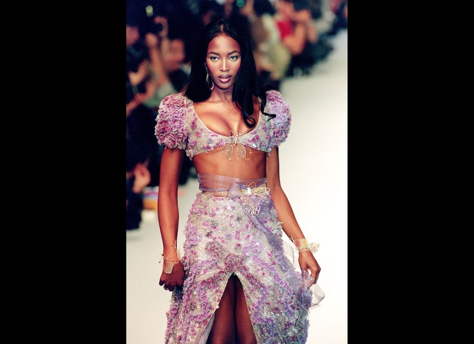 PARIS, FRANCE: Top model Naomi Campbell displays a dress during the presentation of Karl Lagarfeld's 1994 Spring/Summer haute