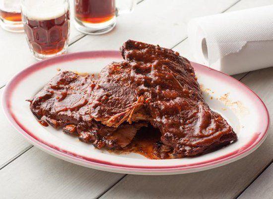 "Get the <a href=""http://www.cookingchanneltv.com/recipes/kansas-city-style-ribs-recipe/index.html"" target=""_hplink"">Kansas Ci"
