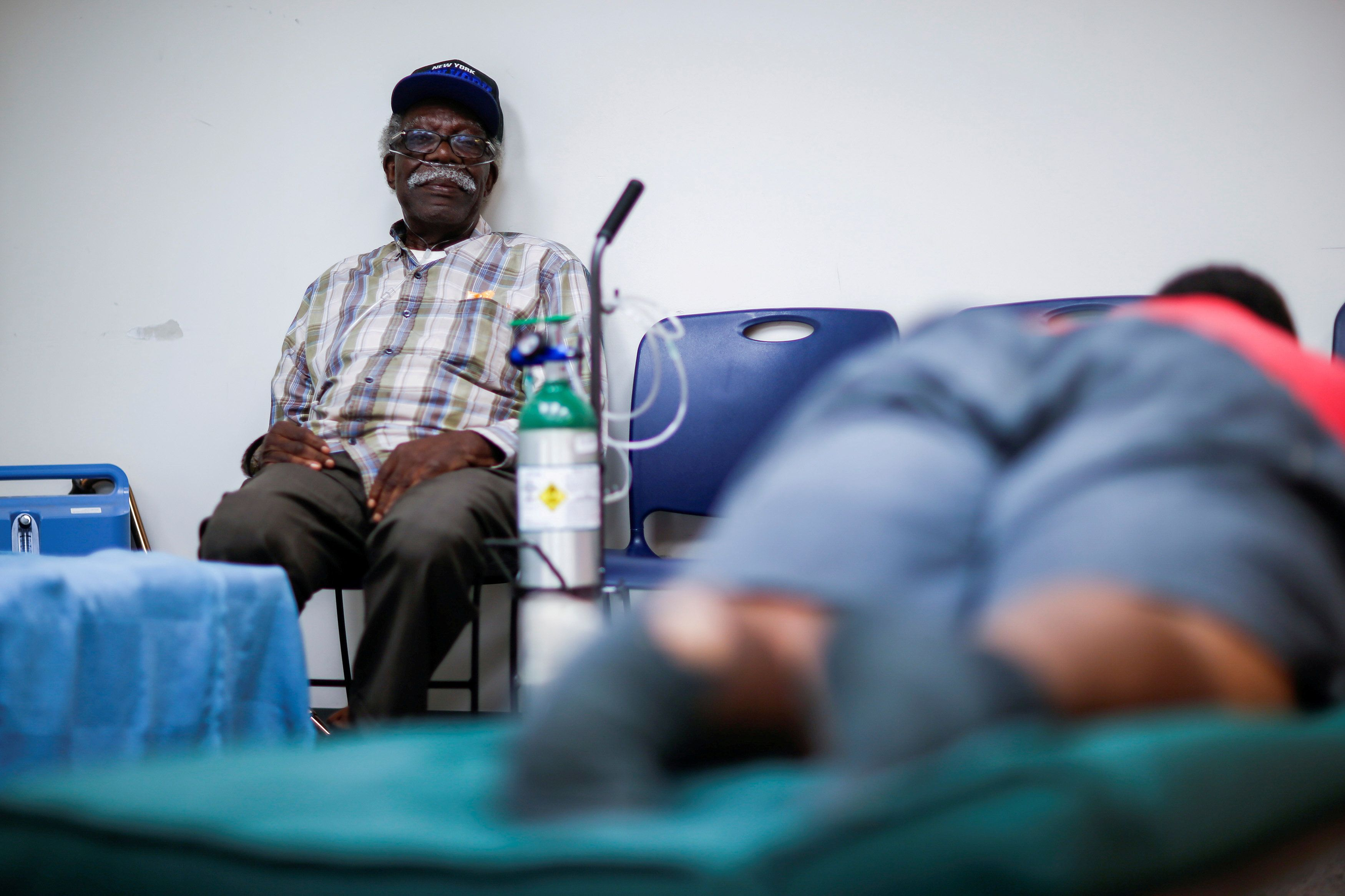 A man using a respiratory machine sits in a shelter run by the Red Cross in Grantsboro, North Carolina, on Sept. 13, 2018.